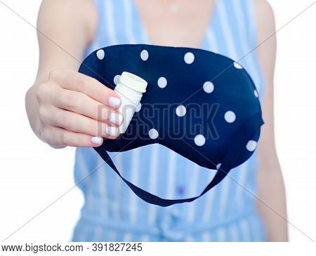 Woman Holding Mask For Sleep And Jar With Sleeping Pill On White Background Isolation