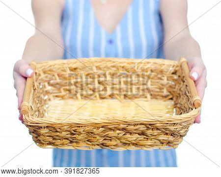 Woman Holding Empty Basket In Hand On White Background Isolation