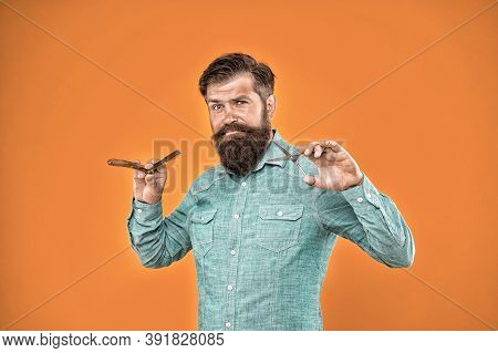From Old-fashioned To Hipster Chic. Hipster Hold Shaving Tools Yellow Background. Professional Barbe