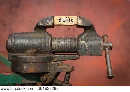 Concept Of Dealing With Problem. Vice Grip Tool Squeezing A Plank With The Word Shuffle
