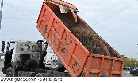 Raised Bucket Of A Truck, Unloading Sand