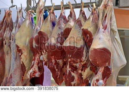 Butcher Shop With Hanged Fresh Red Meats