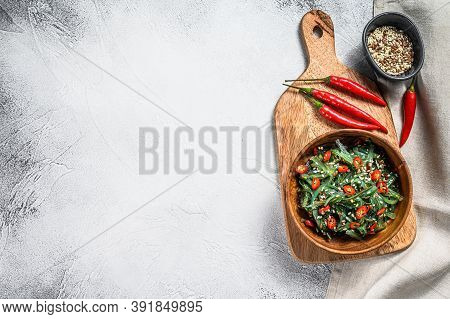 Healthy Seaweed Chuka Salad With Greens And Red Chili Pepper. Gray Background. Top View. Copy Space