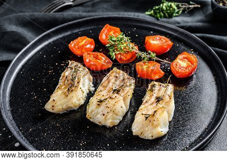 Baked Cod Fish Fillet With . Black Background. Top View