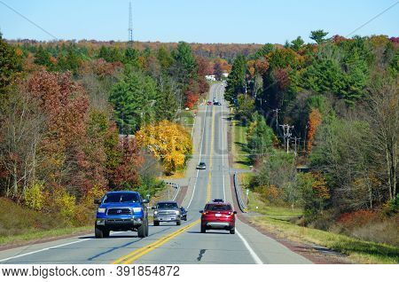 Jim Thorpe, Pennsylvania - October 17,2020 - The Traffic On Route 903 Surrounded By The Fall Foliage