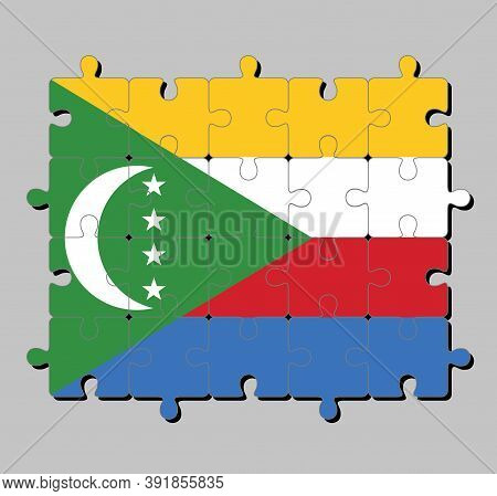 Jigsaw Puzzle Of Comoros Flag In Yellow White Red And Blue With  Green Chevron, Crescent And Star. C