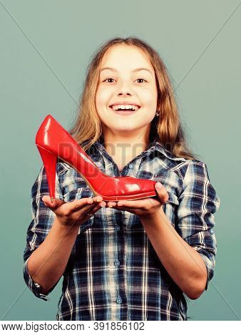 Look Perfect. Happy Childhood. Small Girl With Stylish Shoes. Happy Child Hold Fashionable Shoe. Hig