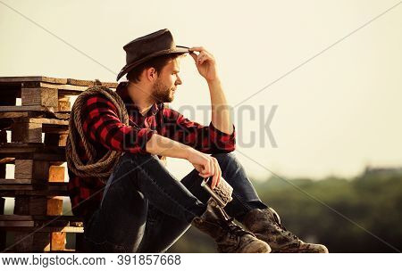 Watching Sunset. Farmer Cowboy Handsome Man Relaxing After Hard Working Day At Ranch. Romanticism We