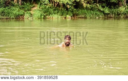 Best Way To Relax. Brutal Hipster With Wet Beard. Refreshing In River Water. Water Beast. Furry Mons