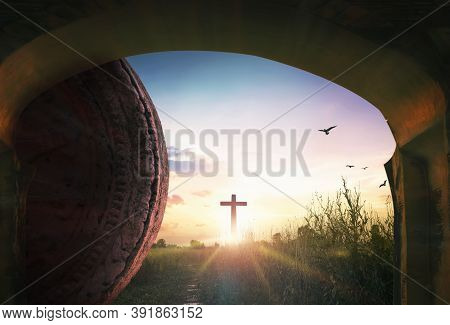 Easter Concept: Tomb Stone With Holy Cross And Sunset Sky Background