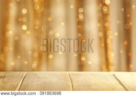 Defocused Background Christmas Wood Table Top With Warm Blurred Bokeh Of  Glittering Lights .christm