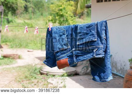Shorts Blue Jeans Hanging For Drying In Sunlingt After Washed
