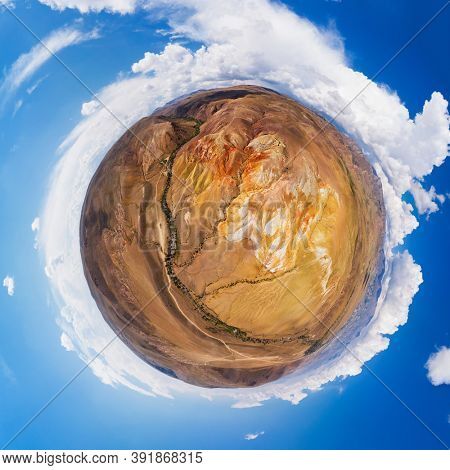 Little planet transformation of spherical panorama 360 degrees of colorful eroded landform of Altai mountains with yellow, brown and red colors. Nature landscape called Altai Mars, Altai Republic