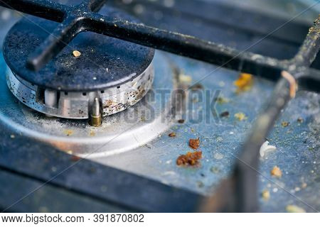 Dirty Gas Stove Top With Food Leftovers. Unclean Steel Kitchen Cooktop With Greasy Spots. Spring-cle