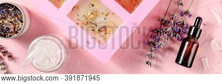 Handmade Soap Ingredients Panorama On A Pink Background. Glycerin, Lavender, Essential Oil, And A Sp