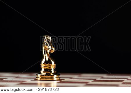 Golden Knight Chess Figure Standing On Chessboard. Intellectual And Tactic Game. Strategy Planning,