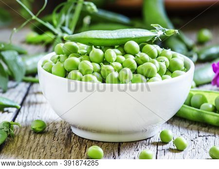 Peeled Pea Green Peas In A White Porcelain Bowl, Vintage Wooden Background, Selective Focus