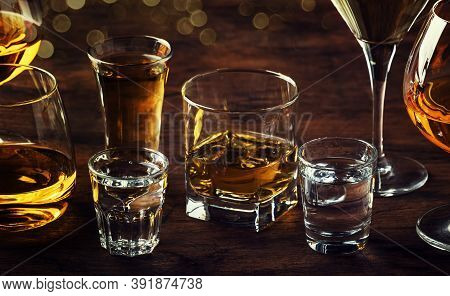 Selection Of Hard Strong Alcoholic Drinks Big Glasses And Shot Glass In Assortment: Vodka, Cognac, T