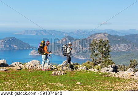Group of backpackers hiking in mountains outdoor active lifestyle travel adventure vacations journey  freedom Summer landscape Hike concept