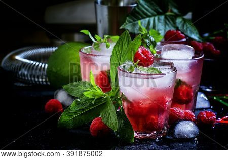 Raspberry Mojito Alcoholic Cocktail With Berries, Lime, Mint And Ice, Black Background, Selective Fo
