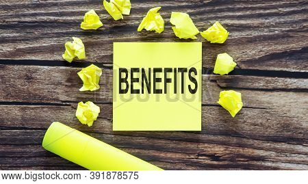 Benefits Notes About Benefits ,concept On Yellow Stickers On Wooden Background