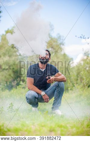 Stylish Brutal Man Blows Up A Couple An Electronic Cigarette. Electronic Cigarette As Alternative To