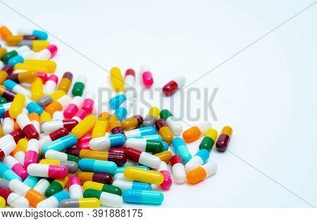 Pile Of Colorful Antibiotic Capsule Pills. Antibiotic Drug Resistance Concept. Pharmaceutical Indust