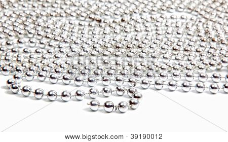 Silver Beads On White Background