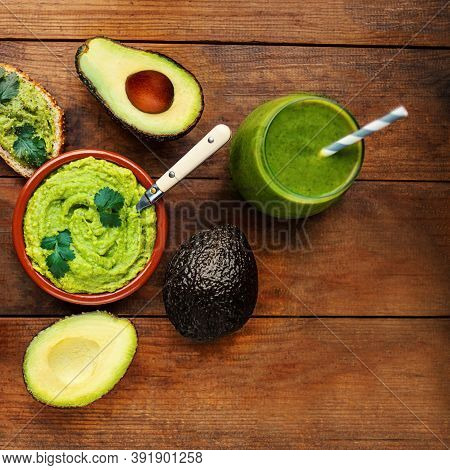 Mexican Dip Sauce Guacamole With Avocado Toast  On Old Wooden Table, Copy Space. Avocado Spread Top