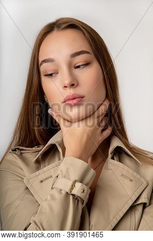 Throat Pain Concept. Young Woman In Coach With Touching Her Throat.