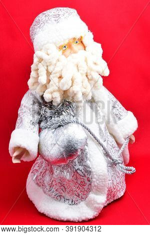 Christmas Tree Toys, Elegant Santa Claus, With Mshek Gifts For Children, On A Red Background