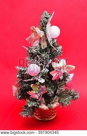 Christmas Toys, Artificial Christmas Tree, On Branches Toys And Gifts, On A Red Background