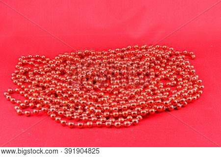 Christmas Decorations, Red Beads, Garlands, On A Red Background Decorations