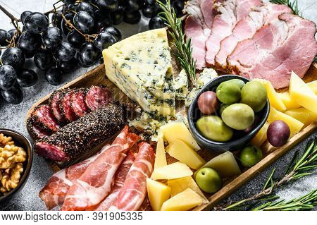 Italian Appetizers Or Antipasto Set Mixed Delicatessen Of Cheese And Meat Snacks. Gray Background. T
