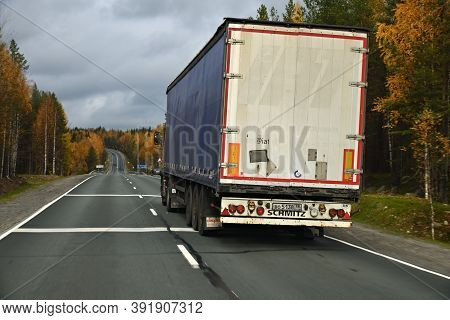 Karelia, Russia - September 30, 2020: Truck Goes Along The Highway Through The Autumn Forest, Trucki
