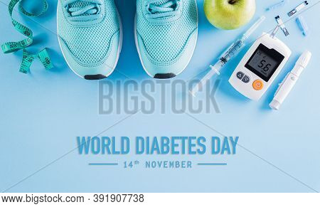 Top View Of Diabetes Tester Set With Sport Shoes, Measuring Tape And  Green Apple On Bright Blue Pas
