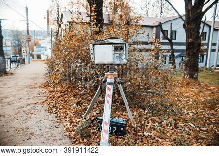 Laser Radar Measuring Vehicle Speed. Traffic Police Camera Of Photo And Video Fixation On A Tripod.
