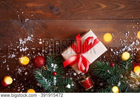 Christmas Greeting Card Concept. Gift Box With Christmas Tree And Decoration On Wooden Background. C