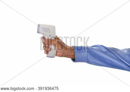 Hands Of An Elderly Man Holding Infrared Thermometer (thermometer Gun) Isolated On White Background.