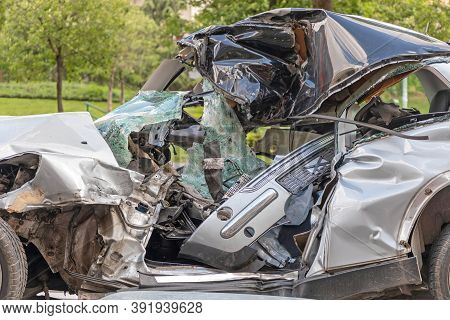 Crushed Small Car Damaged In Traffic Accident
