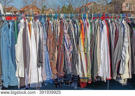 Garment Clothing Hanging On Rails At Flea Market