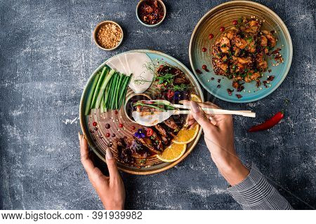 Woman Hand Holding Chinese Food, A Woman Eats Beijing Duck, Delicious Peking Roast Duck Dish, One Of