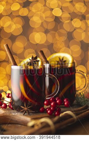 Two Glasses Of Hot Red Mulled Wine With Spices, Orange Slices, Cinnamon Stick And Anise Star Placed