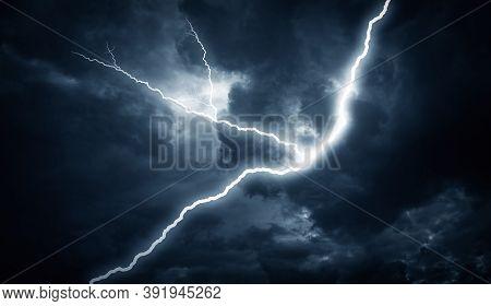 Lightning Strike On The Cloudy Dark Sky. Lightning Strike In The Darkness.