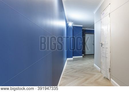 Empty Unfurnished Corridor With Minimal Preparatory Repairs With Crown Moulding. Interior Of White A