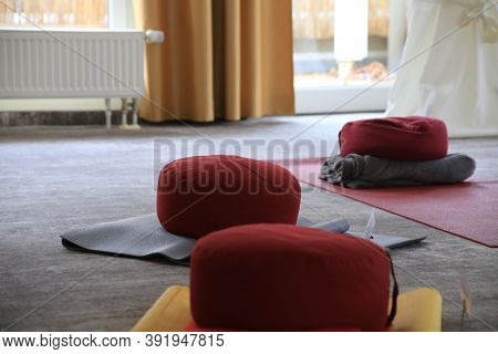 Yoga Room With Mats And Pillows Without People
