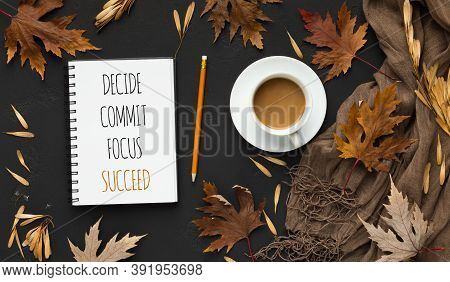 Plan Your Success. Notepad With Goals And Words Decide, Commit, Focus And Succeed Over Black Autumn