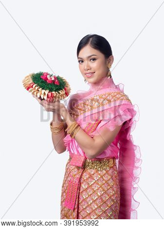 Attractive Thai Woman Dressed In Traditional Thai Clothes Holds A Flower Basket Made From Natural Ma