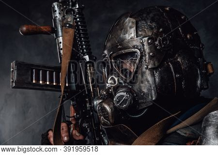 Headshot Of Ragged Stalker In Helmet With Broken Glass And Custom Armour With Riffle In Dark Backgro