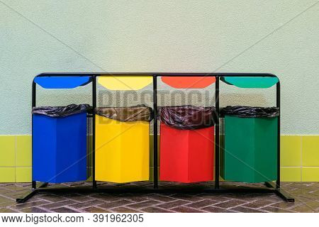 Four Colored Bins For Separate Garbage. Separate Collection Of Glass, Metal, Paper And Plastic.